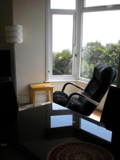 Relax in a swivel chair in the living room bay window and soak in the views.
