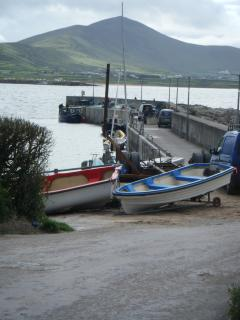 Boats at Ballydavid pier. Cruach Mhárthain in background.