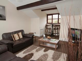 A comfortable lounge to relax in at the end of the day. gas central heating.