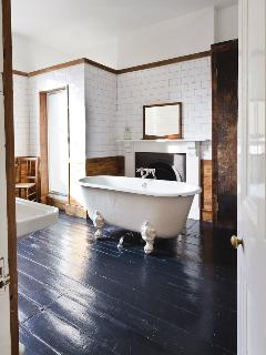 First floor family bathroom, large rain shower & vintage bathtub.