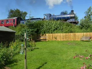 Rear enclosed private garden with Strathspey Steam Railway at end of garden