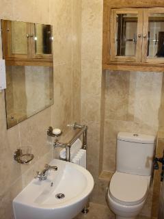Toilet with travertine tiles