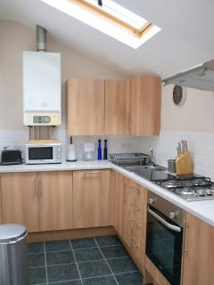 The extremely well equipped kitchen includes all modern appliances and a slimline dishwasher