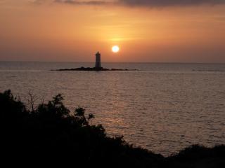 il 'faro di mangiabarche' al tramonto