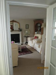 View of sitting room from dining area and kitchen