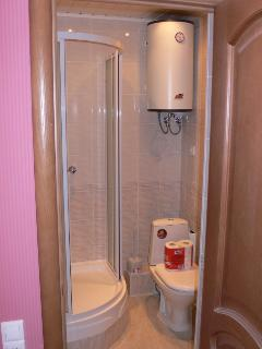 shower room with 2 sources of hot water and heated floors
