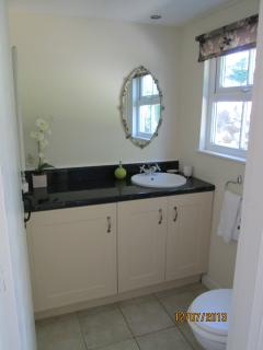 Utility room with WC, off the kitchen ideal for guests sleeping upstairs without disturbing anyone.