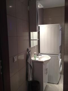 Bathroom with dryer and washing machine