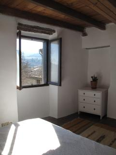The second bedroom, with a view up to the plateau