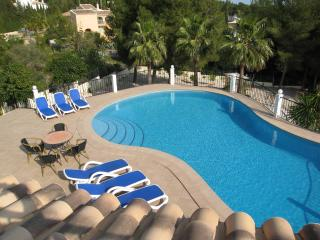 Large swimming pool surrounded by ample terrace