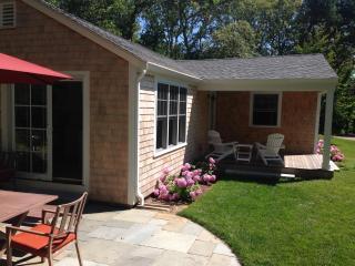 Covered porch and bluestone patio