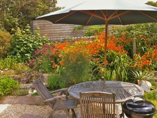 With its own sunny private garden and barbecue