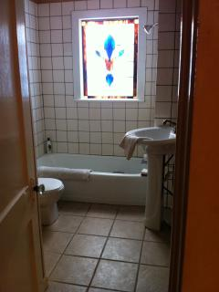 Bathroom with custom art glass window. Lots of natural light.