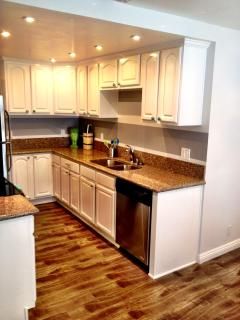 Fully stocked kitchen with granite countertops and everything you need for cooking and baking