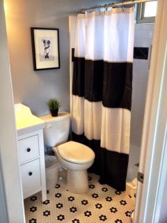 Master 'Minnie' Bathroom with modern hexagon flower tile