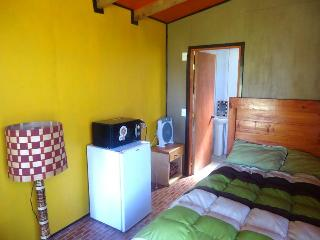 Sleeping room with a bathroom with view on the garden, Panguipulli