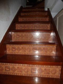 Wooden Staircase with Tile Inlay