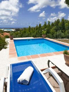Swimming pool and view on orient bay beach
