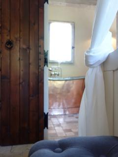 Master bedroom ensuite with copper bateau bath; tropezienne shower