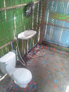 Toilet decorated with colorful river pebbles