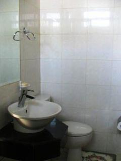 Toilet and sink, towels provided