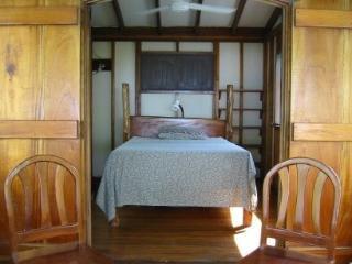 Top floor bedroom with balcony
