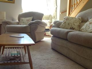 Comfortable seating with reclining armchair and vintage 'Ercol' furniture