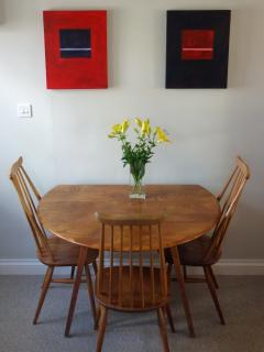 The dining area complete with a beautiful vintage 'Ercol' dining suite and Roberts radio