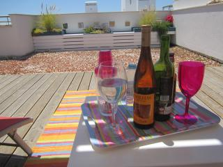 A glass of vinho verde in the sun on your own private roof terrace