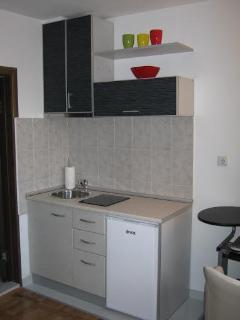 Mini kitchen with a fridge