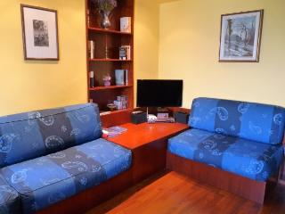 Kitchen/diner/living room with full HD LCD TV, HI-FI system, sofa, table and chairs