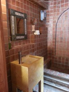 The bathroom with a beautiful design and mexican materials.