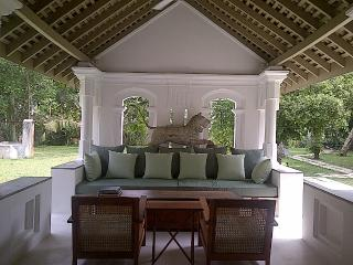 Main sitting/ lounging space looking out to garden and pool