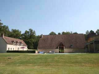 view from the woods, house, barn and private swimming pool
