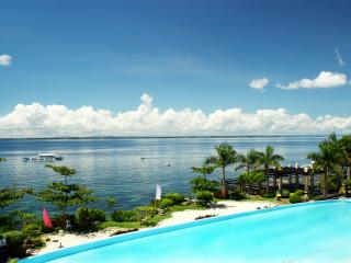 MACTAN ISLAND BEACH RESORT ,1 -Bedrm CONDO/HOTEL, 4 POOLS,Gym , Sleeps 5   !