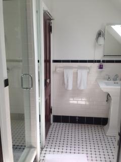 The third floor bathroom has a walk-in shower.
