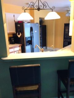 Fully equipped kitchen with appliances and plates, glasses ,silverware etc