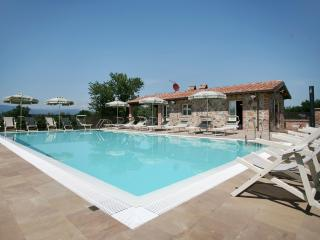 Pool and adjacent sunbathing, dining area (table seats 12) including bathroom, shower and barbecue.