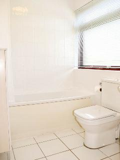 The Master Bedroom has a fully tiled En-Suite Bathroom with a Shower over the Bath Tub