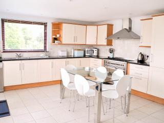 Fully equipped Dining Kitchen with six-burner double-oven cooker. Opens directly to the Patio.
