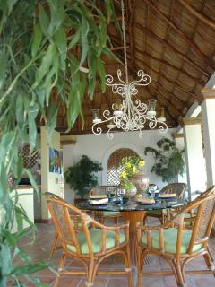 Dine under the magnificent palapa roof