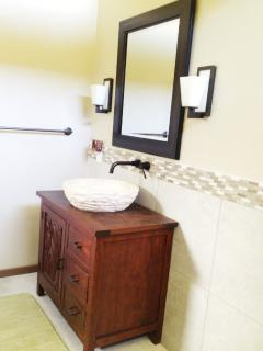FROM BALI, CARVED PEDESTAL SINK AND CABINET.