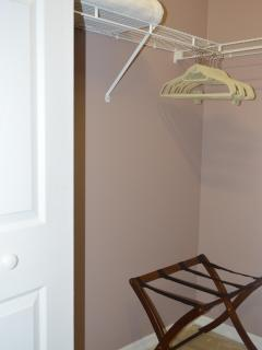 Walk in closet in three bedrooms with luggage racks