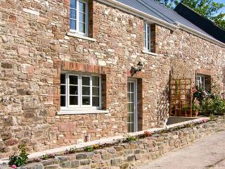 CORRAN COTTAGE, barn conversion with woodburner, country setting, next to, Laugharne