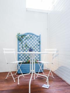exotic wooden terrasse with salon de jardin next to the bedroom
