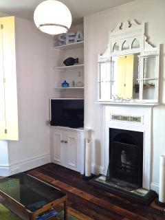 period features in the living room, recycled wooden floor from old school beams