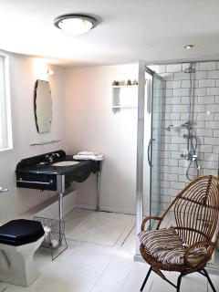 spacious white painted  lovely shower room with two feature Waldorf Hotel vanity units
