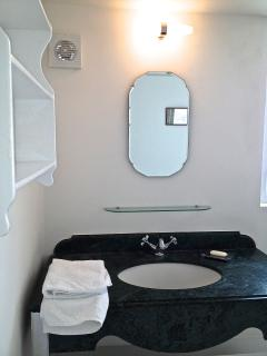 1940s mirrors over each of the recycled feature marble and chrome period vanity units