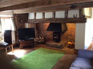 Inglenook fireplace. Tv dvd player. Two sofas. Table seats 4.