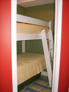 Bunk beds with oversize twin mattresses.